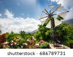 old style windmills used as... | Shutterstock . vector #686789731