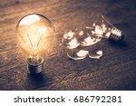 glowing and broken light bulb...   Shutterstock . vector #686792281