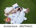 happy family relaxing at the... | Shutterstock . vector #686794621
