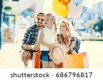 happy family walking along the... | Shutterstock . vector #686796817