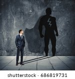 businessman with his shadow of... | Shutterstock . vector #686819731