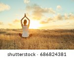 yoga outdoor. happy woman doing ... | Shutterstock . vector #686824381