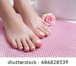 pink perfect pedicure on feet.... | Shutterstock . vector #686828539