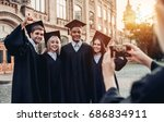 making photo of graduates in... | Shutterstock . vector #686834911