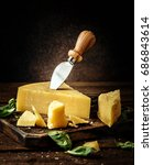 parmesan cheese on wooden board ... | Shutterstock . vector #686843614