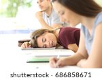 tired student sleeping during a ... | Shutterstock . vector #686858671
