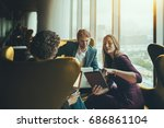 group of three business people... | Shutterstock . vector #686861104