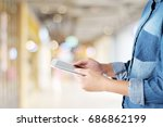 hand using tablet over blur... | Shutterstock . vector #686862199