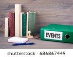 events. binder on desk in the... | Shutterstock . vector #686867449