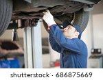 portrait of a mechanic... | Shutterstock . vector #686875669