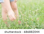 kid hand keeping the flower | Shutterstock . vector #686882044