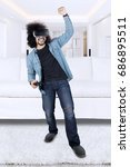 full length of happy afro man... | Shutterstock . vector #686895511