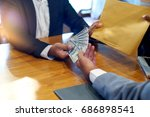 business man give bribe to the... | Shutterstock . vector #686898541