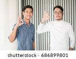 portrait of a happy young man... | Shutterstock . vector #686899801