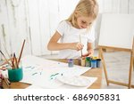 focused and inspired little... | Shutterstock . vector #686905831