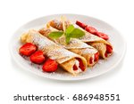 crepes with strawberries and... | Shutterstock . vector #686948551