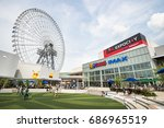 Small photo of OSAKA, JAPAN - JULY 10, 2016: the LaLaport EXPO CITY with Ferris wheel. this place is a collection of shops and restaurants with a beguiling dash of entertainment.