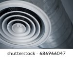 Small photo of closeup air hole grill of interior air duct of cooling air conditioners metal pipe in the building.