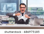 angry businessman with too much ... | Shutterstock . vector #686975185
