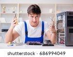 computer repairman repairing... | Shutterstock . vector #686994049