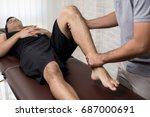 therapist treating injured leg... | Shutterstock . vector #687000691
