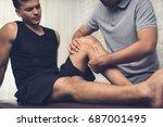 therapist treating injured knee ...   Shutterstock . vector #687001495
