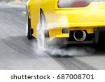 race car burns rubber off its...