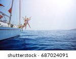 boy with his sister jump in sea ... | Shutterstock . vector #687024091