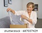portrait of cheerful senior... | Shutterstock . vector #687037429