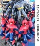 Small photo of SACRAMENTO, CALIFORNIA, USA - JUL 24, 2017: State Fair at Cal Expo . Spiderman and Batman Inflatable toys
