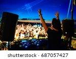 dj and dance floor with hands...   Shutterstock . vector #687057427