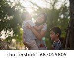 single mom walking with son... | Shutterstock . vector #687059809