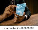 businessperson holding... | Shutterstock . vector #687063235