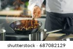 professional chef cooks flambe...   Shutterstock . vector #687082129