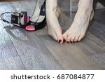 young woman suffering from legs ... | Shutterstock . vector #687084877