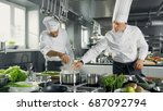 two famous chefs work as a team ...   Shutterstock . vector #687092794