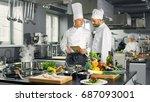 two famous chefs exchange ideas ... | Shutterstock . vector #687093001
