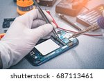 the asian technician repairing... | Shutterstock . vector #687113461