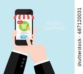 businessman's hand holding... | Shutterstock .eps vector #687120031