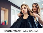 hairstylist deciding with the... | Shutterstock . vector #687128761