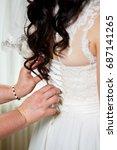 the bride getting her dress... | Shutterstock . vector #687141265