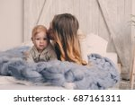 happy mother and baby playing... | Shutterstock . vector #687161311