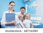 Family at a reception at the dental clinic - stock photo