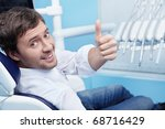 A young man in a dental chair - stock photo