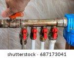 home water supply  hand turn... | Shutterstock . vector #687173041