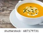 pumpkin soup in white bowl on... | Shutterstock . vector #687179731