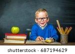 happy cute clever boy is... | Shutterstock . vector #687194629