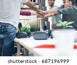 young work team putting hands... | Shutterstock . vector #687196999