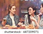 attractive girl telling funny... | Shutterstock . vector #687209071