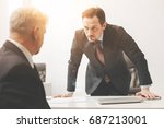 Small photo of Young ambitious businessman angry with his employee